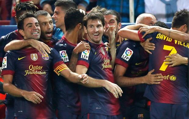 Barcelona comemora gol sobre o Sevilla (Foto: Reuters)
