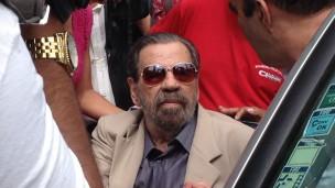Paulo Malhães chega para depor à CNV (Foto: BBC)