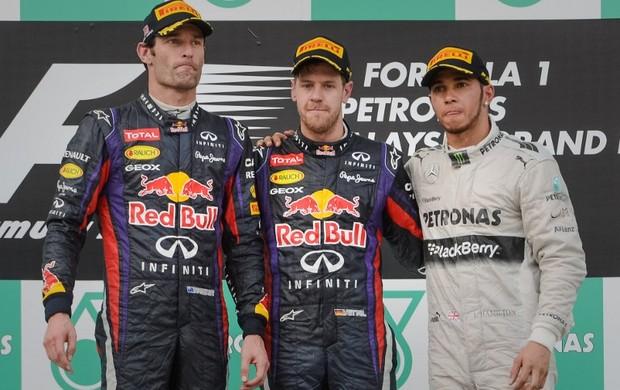 Mark Webber, Sebastian Vettel e Lewis Hamilton no pódio do GP da Malásia (Foto: AFP)