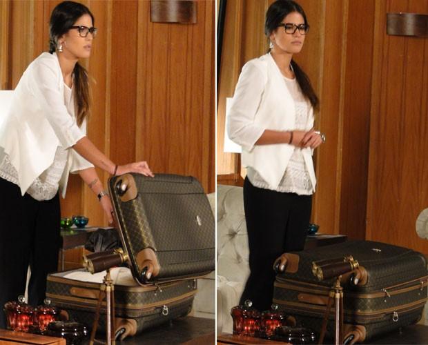 O que será que Isadora guarda tão misteriosamente em sua mala? (Foto: Guerra dos Sexos / TV Globo)