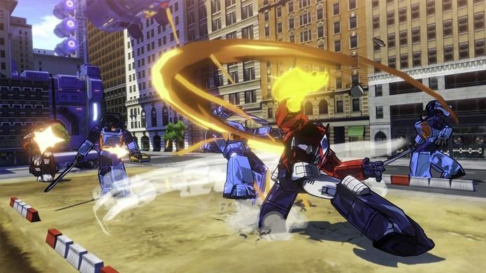 Optimus Prime enfrenta hordas de decepticons com seu machado de energia (Foto: Reprodução/Gematsu)