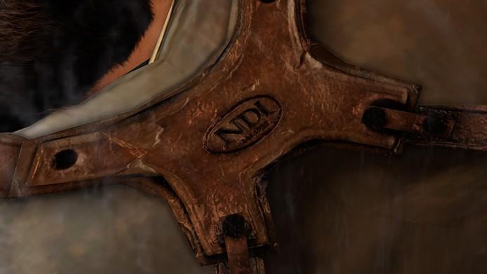 Sigla pode ser vista no equipamento do personagem (Foto: Reprodução/UnchartedWikia)