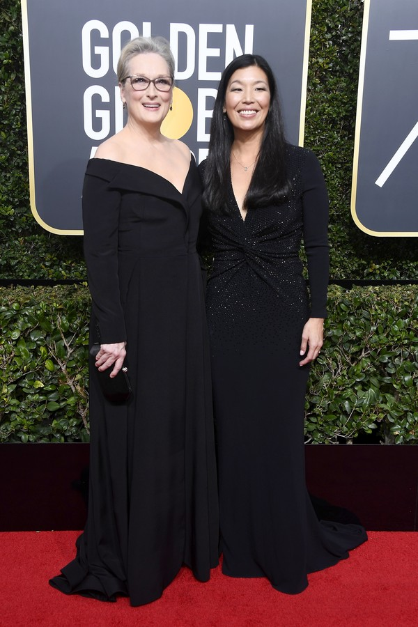 BEVERLY HILLS, CA - JANUARY 07:  Actor Meryl Streep (L) and NDWA Director Ai-jen Poo attend The 75th Annual Golden Globe Awards at The Beverly Hilton Hotel on January 7, 2018 in Beverly Hills, California.  (Photo by Frazer Harrison/Getty Images) (Foto: Getty Images)