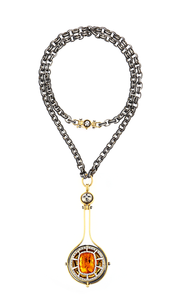 "The ""Pluton"" pendant necklace from the ""Sirius"" collection in open position, revealing a citrine orb (Foto: ELIE TOP)"