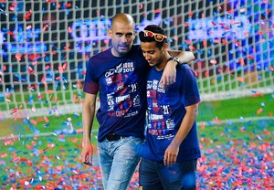 Thiago Alcantara e Guardiola pelo Barcelona (Foto: Getty Images)
