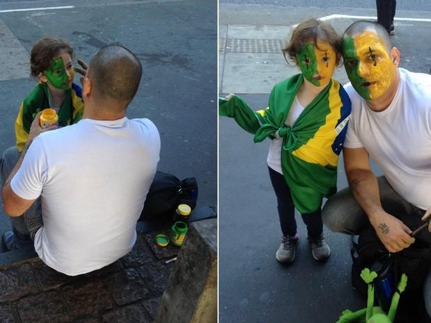SÃO PAULO: Erick Dolce, 39 anos, pinta o rosto da filha Isabela, 3 anos. Ele diz que está na manifestação para pedir educação e saúde.