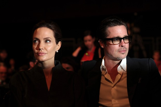 Angelina Jolie e Brad Pitt no Global Summit to End Sexual Violence in Conflict em Londres - Junho de 2014 (Foto: AFP)