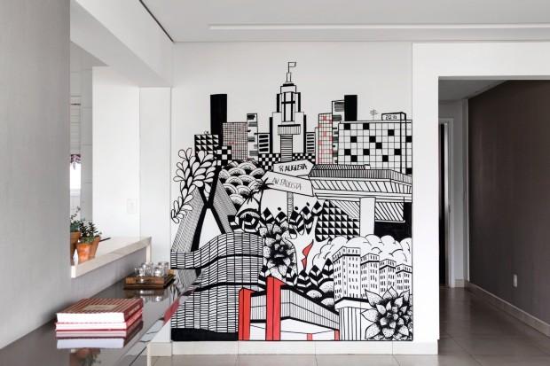 Construções ícones da cidade de São Paulo, como o Masp, estampam a parede da sala da enfermeira Marcela Vulcano (Foto: Edu Castello / Editora Globo)