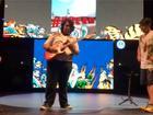 Menino vence concurso no Rock in Rio e ganha guitarra autografada