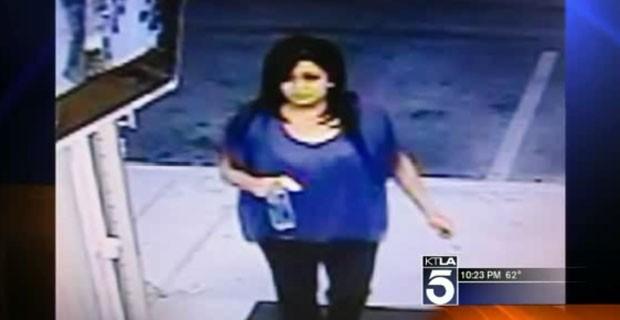 Ganhadora de US$ 23 milhões na loteria em imagem de câmera de segurança da loja onde o ticket foi comprado (Foto: Reprodução)
