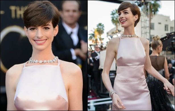 """Anne Hathaway """"causou"""" no Oscar 2013. Motivo: compareceu com um vestido rosa clarinho que deixou notórios os mamilos intumescidos. Após o episódio, a premiada atriz pediu desculpas pelos """"faróis acesos"""". (Foto: Getty Images)"""