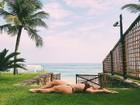 Giselle Prattes mostra corpão em dia de folga na praia