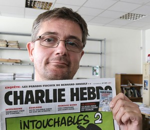 O diretor da revista, Stéphane Charbonnier, conhecido com Charb, foi um dos mortos (Foto: AP Photo/Michel Euler, File)