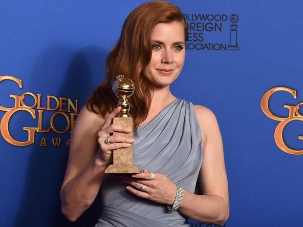 Amy Adams venceu o Globo de Ouro de melhor atriz de comédia ou musical por 'Grandes olhos'. (Foto: Jordan Strauss/Invision/AP)
