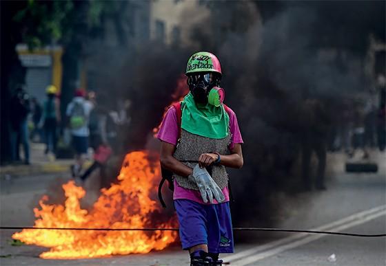 Protestos na Venezuela  (Foto: AFP PHOTO / RONALDO SCHEMIDT)