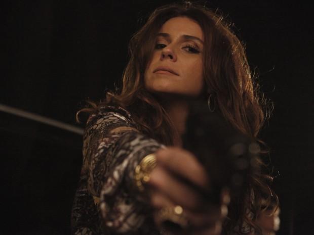 Helô aponta arma para assassino (Foto: Salve Jorge/TV Globo)