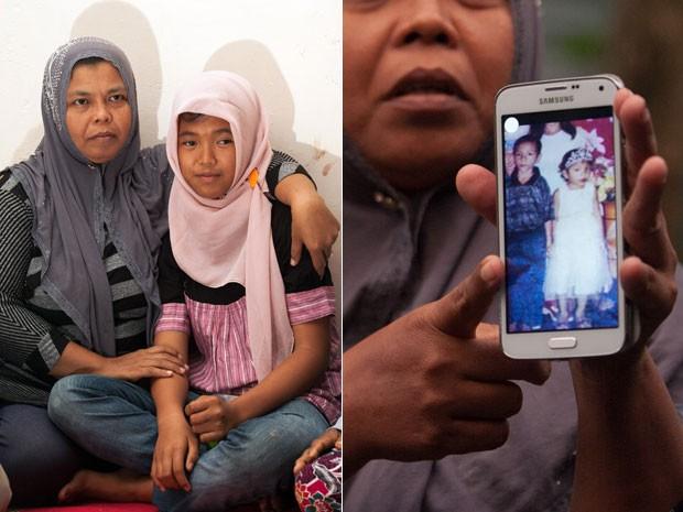 A menina Raudhatul Jannah reencontrou a mãe Jamaliah após terem se separado durante o tsunami de 2004 (Foto: Chaideer Mahyuddin/AFP)