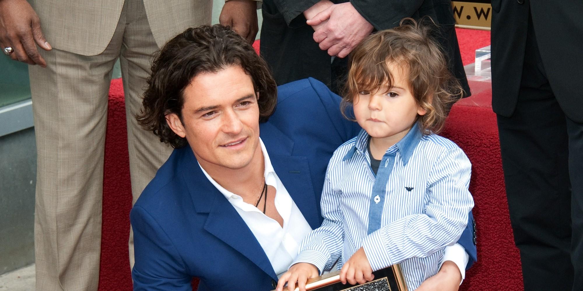 Orlando Bloom com seu filho (Foto: Divulgação)