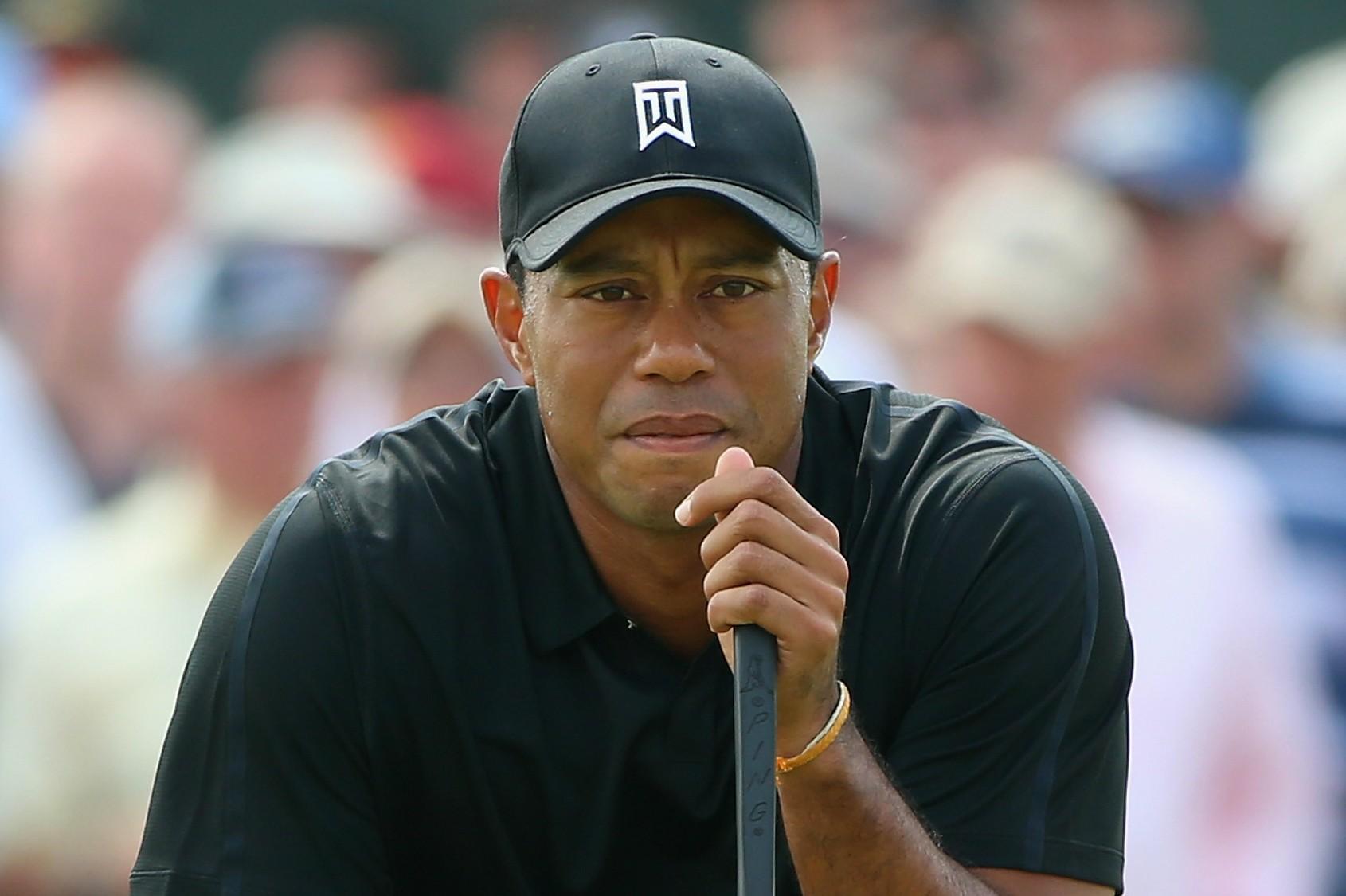 O golfista profissional Tiger Woods é outro que culpou o vício em sexo pelo sem-número de traições contra a ex-esposa, a modelo sueca Elin Nordegren. (Foto: Getty Images)