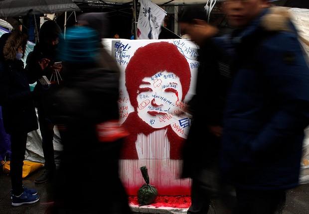 Protesto nas ruas de Seul contra a presidente sul-coreana Park geun-hye (Foto: Woohae Cho/Getty Images)