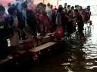 Crianças ficam ilhadas após escola ser inundada durante temporal