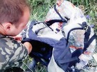Novo vídeo mostra suposto saque em destroços do voo MH-17 na Ucrânia