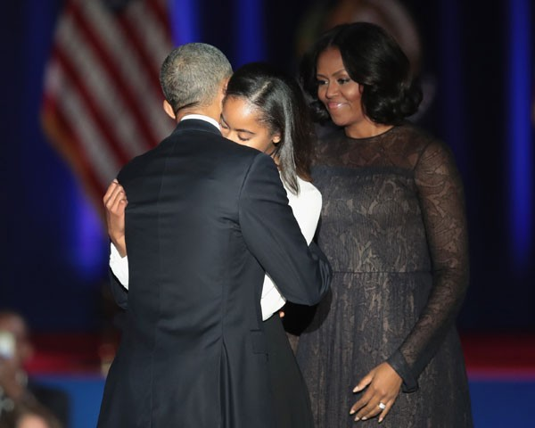 Barack Obama, Michelle e a filha Malia (Foto: Getty Images)