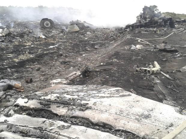 Destroços do avião da Malysia que caiu na Ucrânia (Foto: Maxim Zmeyev/Reuters)