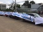 Funcionários e demitidos de gráfica em Itaquaquecetuba protestam