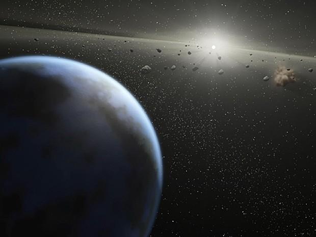 Concepção artística mostra cinturão massivo de asteroides ao redor de estrela da mesma idade e tamanho do Sol (Foto: Nasa/JPL-Caltech/T. Pyle (SSC) )