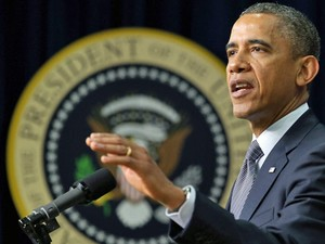 O presidente americano, ao anunciar a nova proposta de lei para controle de armas em Washington, no dia 16 (Foto: AFP)