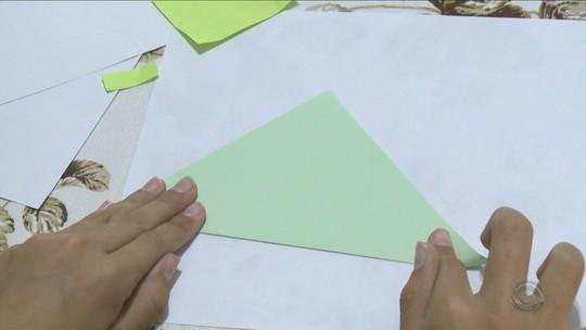 Voluntários do Brasil e dos EUA fazem origamis para reestreia da Chape