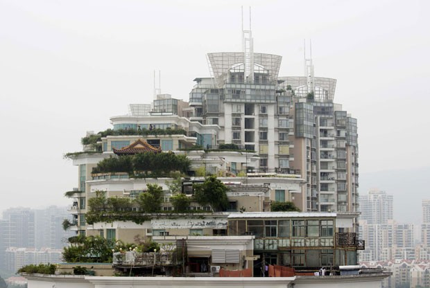 Templo construído no topo de prédio na China deve ser demolido (Foto: Tyrone Siu/Reuters)