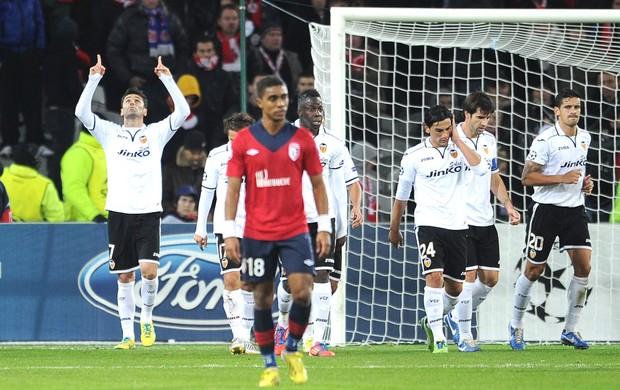 Comemoração do jonas do Valencia contra o Lille (Foto: Agência AFP)