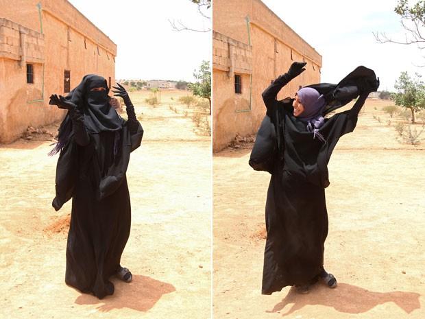 Mulher tira o niqab (véu preto que cobre todo o rosto, menos os olhos) logo após sua cidade ser libertada do Estado islâmico (Foto: Rodi Said/Reuters)