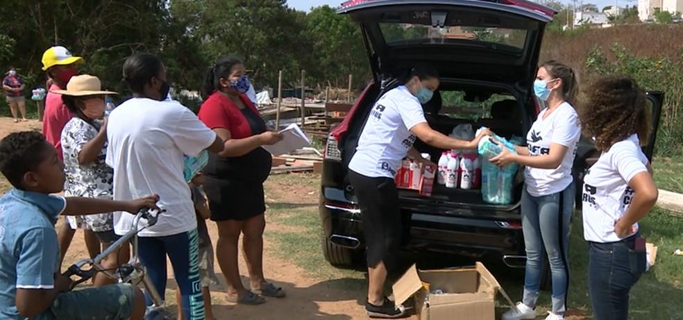 CUFA distribui alimentos em Campinas (SP) — Foto: Reprodução/EPTV