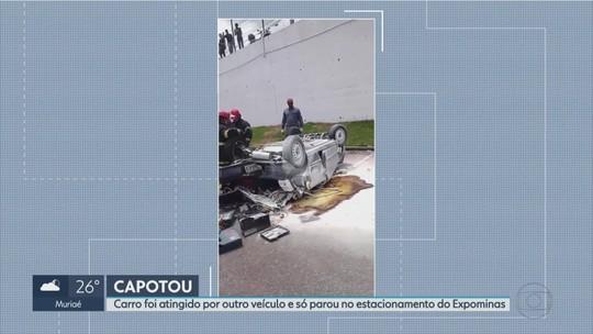 Carro se envolve em acidente, atinge cerca de proteção e cai em estacionamento em BH