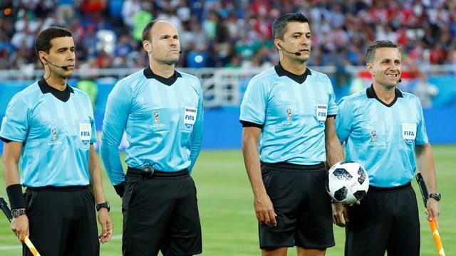 Sandro Meira Ricci e os assistentes do jogo