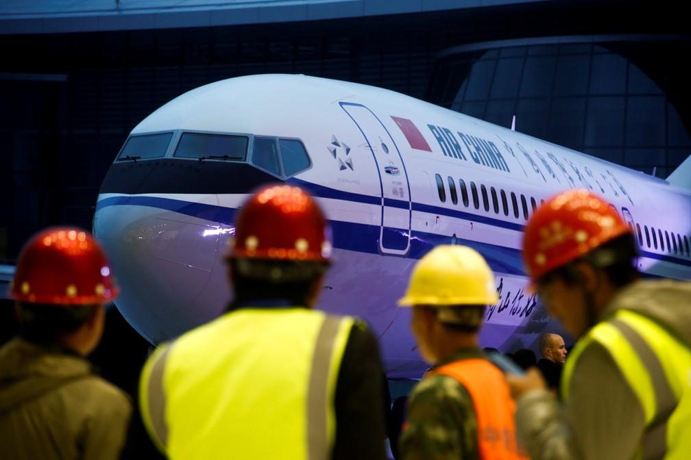 Cerimônia de entrega do Boeing 737 Max 8 para operação na China — Foto: Thomas Peter/Reuters