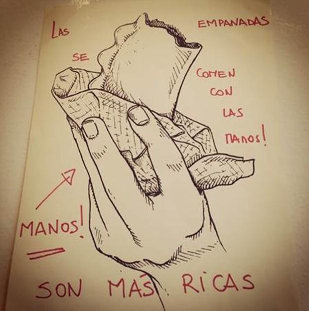 """""""Las empanadas se comen con las manos!"""", aconselha a placa no restaurante La Guapa Empanadas, da chef Paola Carosella (Foto: Mariana Weber/ Divulgação)"""