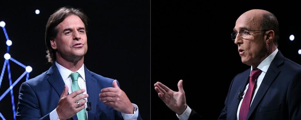 Luis Lacalle Pou (E) e Daniel Martínez (D), candidatos a presidente do Uruguai durante debate eleitoral — Foto: Eitan Abramovich/AFP