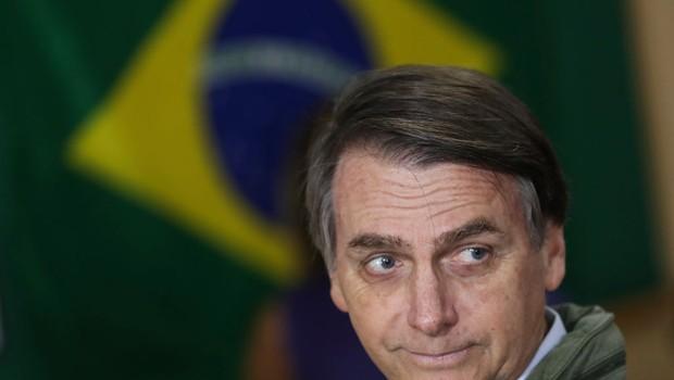 Jair Bolsonaro chega para votar no 2º turno das eleições 2018 (Foto: Ricardo Moraes-Pool/Getty Images)