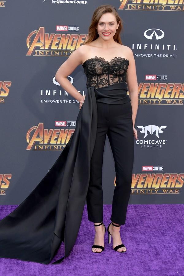 Elizabeth Olsen de macacão Oscar de la Renta. (Foto: Getty Images)