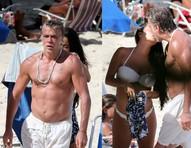 Fábio Assunção troca beijos com a mulher grávida em dia de praia
