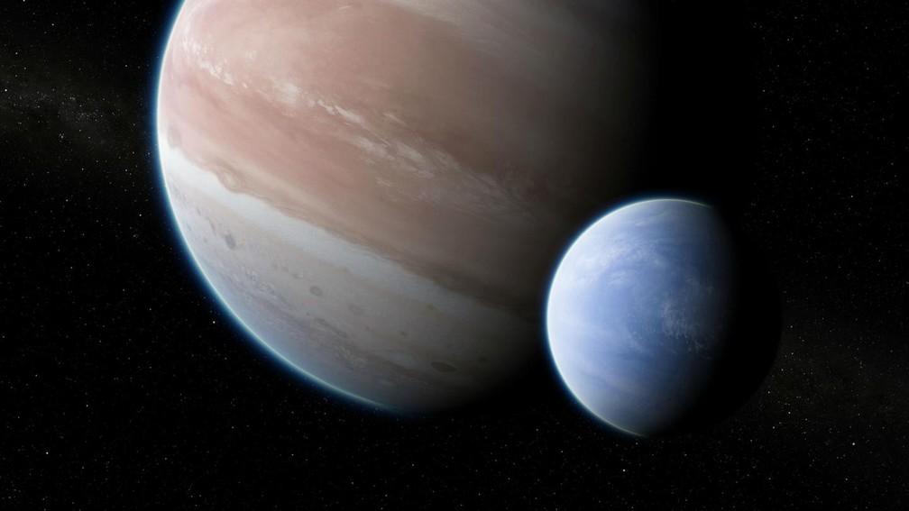 A impressão do artista do exoplaneta Kepler-1625b com sua grande lua hipotética. O par tem uma relação de massa e raio semelhante ao sistema Terra-Lua. — Foto: Dan Durda