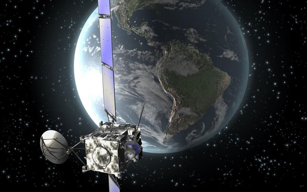 Impressão artística da sonda europeia Rosetta em órbita ao redor da Terra, em novembro de 2009  (Foto: ESA)