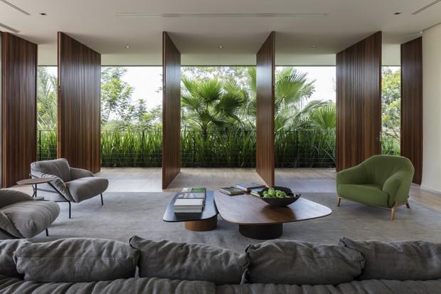 Integração com o verde e minimalismo são destaques desta casa  (Foto: aguirre arquitetura | 2018)