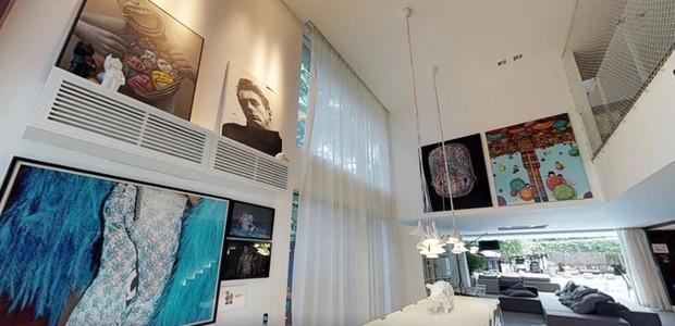 Quadros decoram as paredes e deixam o local mais colorido (Foto: EmCasa/ Reprodução)