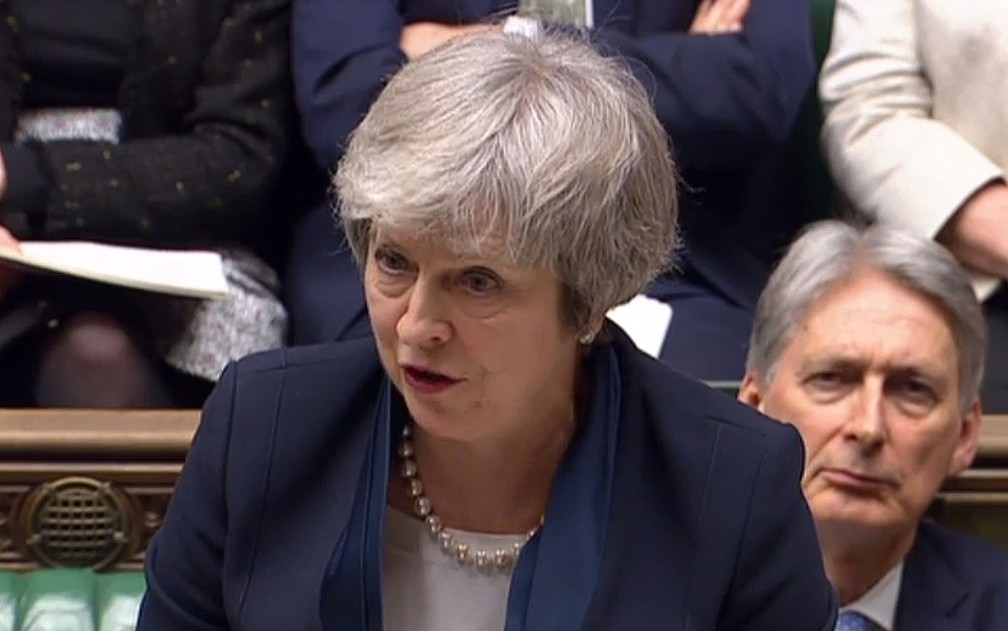 Imagem de vídeo da primeira-ministra britânica Theresa May durante discurso na Câmara dos Comuns, no Parlamento, em Londres, antes da votação do Brexit, na terça-feira (15) — Foto: HO/PRU/AFP