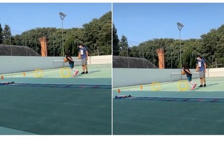 Stefano, outro filho de Mion e Suzana, exercita-se na quadra de tênis Reprodução